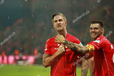 Union's Sebastian Polter (L) celebrates with teammate Christopher Trimmel (R) after scoring the 1-0 lead from the penalty spot during the German Bundesliga soccer match between FC Union Berlin and Hertha BSC in Berlin, Germany, 02 November 2019.