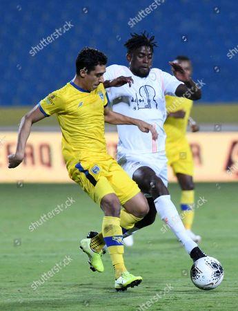 Al- Shabab player Alfred N'Diaye (R) in action against Al-Taawoun player Ibrahim Al Zebeidi (L) during the Saudi Professional League soccer match between Al-shabab and Al-Taawoun at king Abdullah sport city Stadium, Al-Buraidah, Saudi Arabia, 02 November 2019.