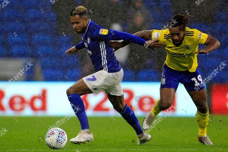 Leandro Bacuna of Cardiff City (left) and Jacques Maghoma of Birmingham City battle for the ball