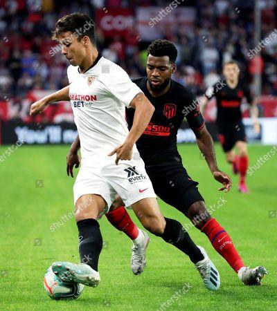 Sevilla's Oliver Torres (L) in action against Atletico's Thomas Lemar (R) during the Spanish La Liga soccer match between Sevilla FC and Atletico Madrid at Ramon Sanchez Pizjuan stadium in Seville, Spain, 02 November 2019.