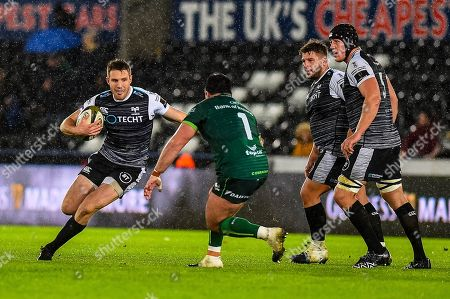 Tom Williams of Ospreys ( with ball ) in action