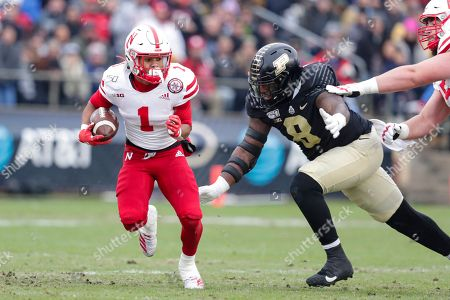 Stock Photo of Wan'Dale Robinson, TJ Sheffield. Nebraska wide receiver Wan'Dale Robinson (1) is chased down by Purdue defensive tackle Anthony Watts (8) during the first half of an NCAA college football game in West Lafayette, Ind