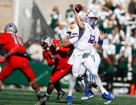R m. Colorado State quarterback Patrick O'Brien, front right, escapes the pocket to throw a pass as UNLV linebacker Javin White, front left, and defensive lineman Nick Dehdashtian pursue in the first half of an NCAA college football game, in Fort Collins, Colo
