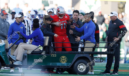 Stock Image of Noah bean, r m. UNLV tight end Noah Bean, center, is helped onto a cart after being injured against Colorado State in the second half of an NCAA college football game, in Fort Collins, Colo. Colorado State won 37-17
