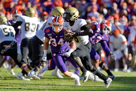 Wofford quarterback Joe Newman rushes out of the backfield during the first half of an NCAA college football game against Clemson, in Clemson, S.C