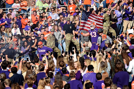 """Dabo Swinney, Chad Smith. Clemson head coach Dabo Swinney, left, leads Chad Smith down """"The Hill"""" before the start of an NCAA college football game against Wofford, in Clemson, S.C"""