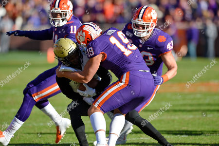 Stock Picture of Tanner Muse, Chad Smith, Isaiah Simmons, T.J. Luther. Clemson's Tanner Muse (11) Chad Smith (43) and Isaiaih Simmons (11) tackle T.J. Luther during the first half of an NCAA college football game, in Clemson, S.C