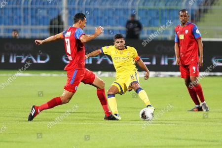 Al-Nassr's Yahya Al Shehri (C) in action against Abha's Karim Aouadhi (L) during the Saudi Professional League soccer match between Al-Nassr FC and Abha Club at Prince Faisal Bin Fahd Stadium in Riyadh, Saudi Arabia, 02 November 2019.