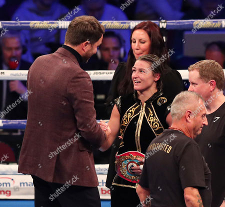 Katie Taylor celebrates at the end of the fight with Eddie Hearn