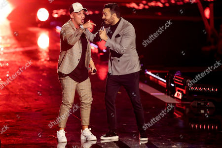 Giovanni Zarrella (R) and German singer Pietro Lombardi (L) perform during the TV show 'Schlagerbooom 2019 - Alles funkelt! Alles glitzert!' (lit.: Hit Booom 2019 - everything sparkles, everything glitters) at the Westfalenhalle in Dortmund, Germany, 02 November 2019.