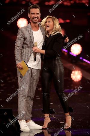 Florian Silbereisen (L) and German singer Helene Fischer (R) onstage during the TV show 'Schlagerbooom 2019 - Alles funkelt! Alles glitzert!' (lit.: Hit Booom 2019 - everything sparkles, everything glitters) at the Westfalenhalle in Dortmund, Germany, 02 November 2019.