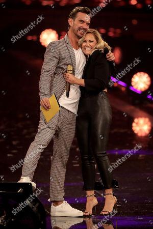 Florian Silbereisen (L) and German singer Helene Fischer (R) attend the TV show 'Schlagerbooom 2019 - Alles funkelt! Alles glitzert!' (lit.: Hit Booom 2019 - everything sparkles, everything glitters) at the Westfalenhalle in Dortmund, Germany, 02 November 2019.