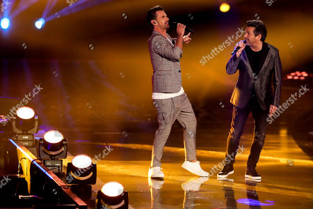 Stock Image of Florian Silbereisen (L) and German singer Thomas Anders (R) perform during the TV show 'Schlagerbooom 2019 - Alles funkelt! Alles glitzert!' (lit.: Hit Booom 2019 - everything sparkles, everything glitters) at the Westfalenhalle in Dortmund, Germany, 02 November 2019.