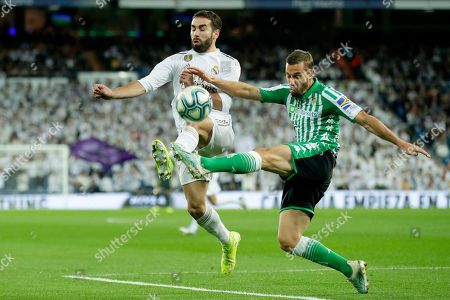 Betis' Sergio Canales vies for the ball with Real Madrid's Dani Carvajal, left, during a Spanish La Liga soccer match between Real Madrid and Betis at the Santiago Bernabeu stadium in Madrid