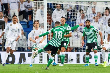 Betis' Andres Guardado (front) in action during the Spanish La Liga soccer match between Real Madrid and Real Betis at Santiago Bernabeu stadium in Madrid, Spain, 02 November 2019.