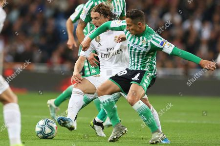 Real Madrid's Luka Modric (L) in action against Betis' Andres Guardado (R) during the Spanish La Liga soccer match between Real Madrid and Real Betis at Santiago Bernabeu stadium in Madrid, Spain, 02 November 2019.