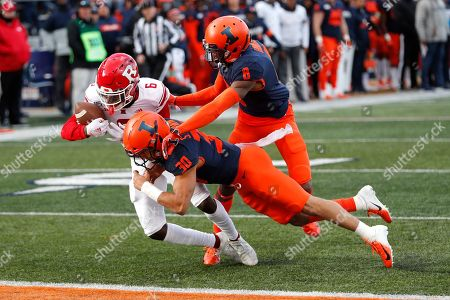 Mohamed Jabbie, Sydney Brown, Tony Adams. Rutgers wide receiver Mohamed Jabbie (6) scores on a pass as Illinois defensive back Sydney Brown (30) and Tony Adams defend during the first half of an NCAA college football game, in Champaign, Ill