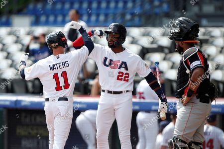 Drew Waters (L) and Jordon Adell (C) of the United States celebrate a race against Holland, during the first game of the Premier 12 tournament, between the US and the Netherlands, at the Charros de Jalisco Baseball Stadium, in the city of Zapopan, Jalisco, Mexico, 02 November 2019.
