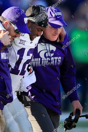 Chris Klieman, AJ Parker. Kansas State head coach Chris Klieman, right, helps AJ Parker (12) from the field with the help of a trainer, left, during the second half of an NCAA college football game against Kansas in Lawrence, Kan., . Kansas State defeated Kansas 38-10