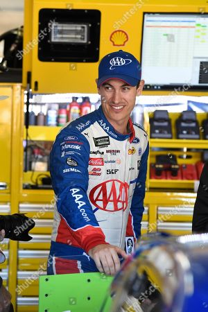 Joey Logano walks through the garage during a NASCAR Cup Series auto race practice at Texas Motor Speedway in Fort Worth, Texas