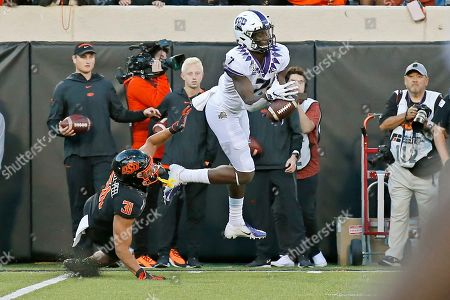 Stock Photo of John Stephens Jr., Kolby Harvell-Peel. TCU wide receiver John Stephens Jr. (7) can't hold onto a pass in front of Oklahoma State safety Kolby Harvell-Peel (31) in the second half of an NCAA college football game in Stillwater, Okla