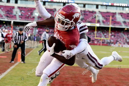 Arkansas receiver Mike Woods pulls in a touchdown catch in front of Mississippi State defender Jay Jimison in the second half of an NCAA college football game, in Fayetteville, Ark