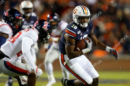 Auburn wide receiver Seth Williams (18) carries the ball as Mississippi defensive back Jay Stanley (28) defends during the second half of an NCAA college football game, in Auburn, Ala