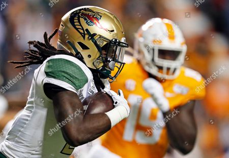 Stock Picture of UAB running back Lucious Stanley (2) runs for yardages as he's chased by Tennessee linebacker Darrell Taylor (19) in the first half of an NCAA college football game, in Knoxville, Tenn
