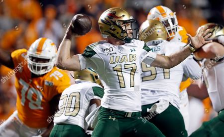 UAB quarterback Tyler Johnston III (17) throws to a receiver in the first half of an NCAA college football game against Tennessee, in Knoxville, Tenn