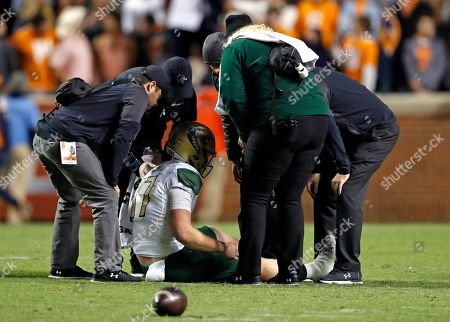 UAB quarterback Tyler Johnston III (17) is attended to after being injured in the second half of an NCAA college football game against Tennessee, in Knoxville, Tenn