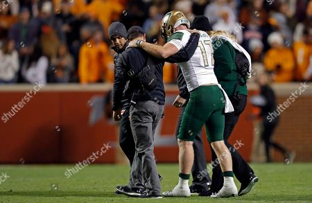 UAB quarterback Tyler Johnston III (17) is helped to the sideline after being injured in the second half of an NCAA college football game against Tennessee, in Knoxville, Tenn