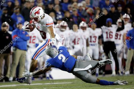 Kylen Granson, T.J. Carter. SMU tight end Kylen Granson (83) pushes past Memphis defensive back T.J. Carter (2) as Grandson scores a touchdown on a 16-yard pass play in the first half of an NCAA college football game, in Memphis, Tenn