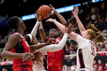 USA forward Nneka Ogwumike (16) shoots as Stanford forward Ashten Prechtel, right, and Stanford guard Kiana Williams, left, defend in the second quarter of an exhibition women's basketball game, in Stanford, Calif