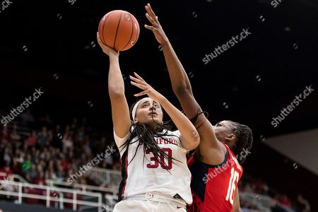 Stanford guard Haley Jones, left, shoots as Team USA forward Nneka Ogwumike defends in the fourth quarter of an exhibition women's basketball game, in Stanford, Calif. Team USA won 95-80