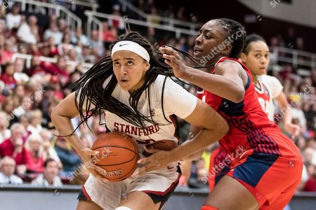 Stanford guard Haley Jones, left, drives to the basket as Team USA forward Nneka Ogwumike defends in the fourth quarter of an exhibition women's basketball game, in Stanford, Calif. Team USA won 95-80