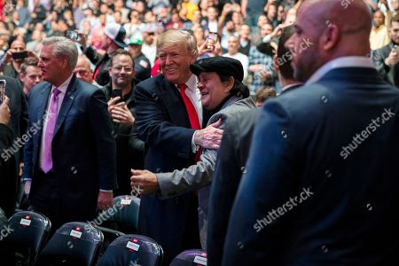 President Donald Trump talks with boxing legend Roberto Duran at Madison Square Garden during the UFC 244 mixed martial arts fights, in New York