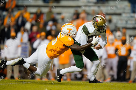 J.J. Peterson #6 of the Tennessee Volunteers tackles Tyler Johnston III #17 of the UAB Blazers during the NCAA football game between the University of Tennessee Volunteers and the University of Alabama at Birmingham Blazers in Knoxville, TN Tim Gangloff/CSM
