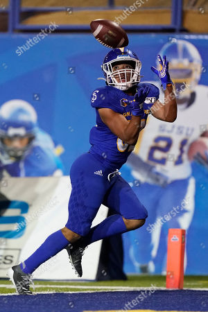 San Jose State wide receiver Isaiah Hamilton catches a pass for a touchdown against Boise State during the first half of an NCAA college football game in San Jose, Calif