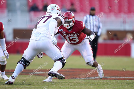 Collin Clay #13 Arkansas defensive lineman follows the eyes of Mississippi State offensive lineman Cordavien Suggs #77. Mississippi State defeated Arkansas 54-24 in Fayetteville, AR, Richey Miller/CSM