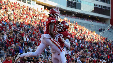 Mike Woods #8 and Koilan Jackson #3 Arkansas receivers celebrate in the end zone. Mississippi State defeated Arkansas 54-24 in Fayetteville, AR, Richey Miller/CSM
