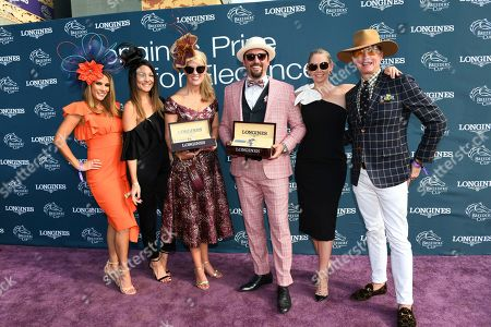 Judges Bonnie-Jill Laflin, Vania Toledo, Kym Johnson and Carson Kressley, left to right, celebrate with Longines Prize for Elegance winners Brittany Durtschi, of Lexington, Kentucky, center left, and Joaquin Mesa, center right, of Los Angeles, Calif., at the 2019 Breeders' Cup, at Santa Anita Park in Arcadia, CA. Longines, the Swiss watch manufacturer known for its elegant timepieces, is the Official Watch and Timekeeper of the Breeders' Cup World Championships