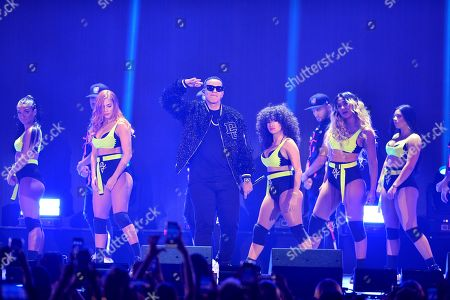 Daddy Yankee performs on stage