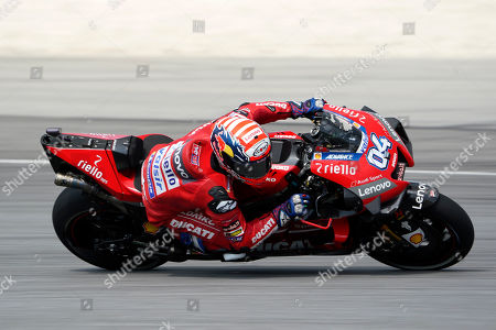 Italy's rider Andrea Dovizioso competes during MotoGP race of the Malaysia Motorcycle Grand Prix at Sepang International circuit in Sepang