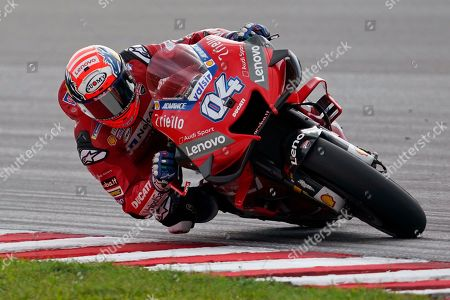 Stock Picture of Italy's rider Andrea Dovizioso competes during MotoGP race of the Malaysia Motorcycle Grand Prix at Sepang International circuit in Sepang