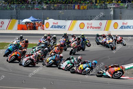 Spain's rider Aleix Espargaro, right, leads the pack during the start of Moto2 race at Sepang International circuit in Sepang
