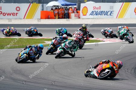 Stock Photo of Spain's rider Aleix Espargaro, right, leads the pack during the second laps of Moto2 race at Sepang International circuit in Sepang