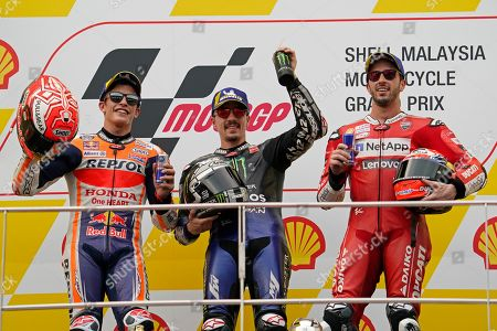 Marc Marquez, Maverick Vinales, Andrea Dovizioso. Second placed Spain's Marc Marquez, left, winner Maverick Vinales of Spain, center, and third-placed Andrea Dovizioso of Italy pose for photo after the MotoGP race at the Malaysia Motorcycle Grand Prix at Sepang International circuit in Sepang