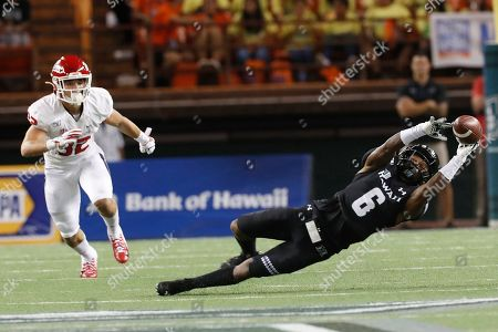 Fresno State defensive back Evan Williams (32) runs as Hawaii wide receiver Cedric Byrd II (6) can't pull in a catch during the first half of an NCAA college football game, in Honolulu