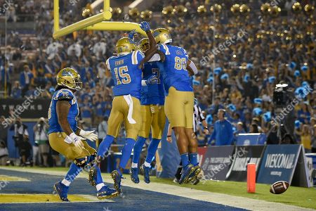 Devin Asiasi, Christaphany Murray, Jaylen Erwin, Kyle Philips. UCLA tight end Devin Asiasi, right, celebrates his touchdown catch with Kyle Philips, second from right, and Christaphany Murray, left, Jaylen Erwin during the second half of an NCAA college football game against Colorado in Los Angeles, . UCLA won 31-14