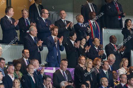 Britain's Prince Harry, Japan's Crown Prince Akishino and Crown Princess Akishino applaud